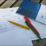 r v Versicherung Werbung mit Kugelschreiber und Block